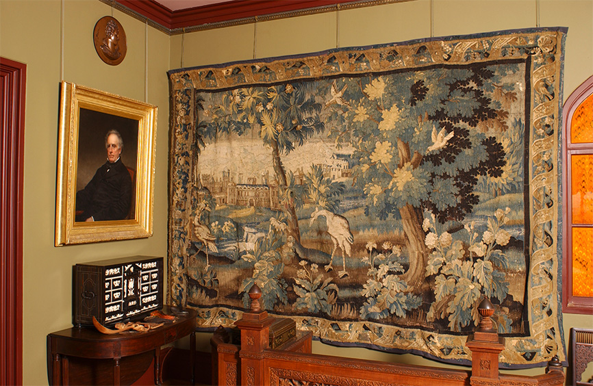 A corner of the corridor, showing an 17-18h-century tapestry and a portrait of Joseph Church, father of Frederic Church. Photograph by Andy Wainwright.